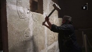 Still from ISIL video of destruction of Nimrud; Aljazeera; April 2015